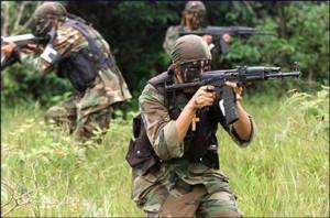 Paramilitary gunmen in Colombia; via flickr