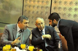 Egyptian Prime Minister Essam Sharaf (on left) confers with advisors; photo by Nabil Omar via flickr