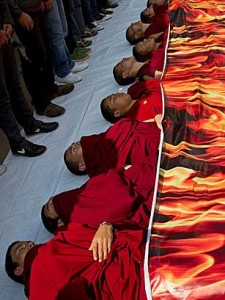 Tibetan monks represent self-immolations