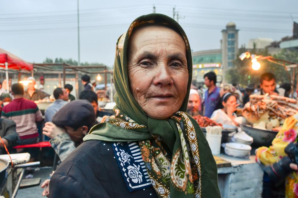 A Uighur woman at a market in Kashgar, China