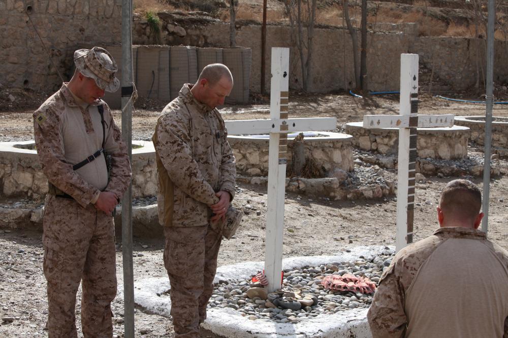 U.S. Marines mourn the deaths of U.S. troops in Kajai, Afghanistan.